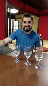 Ryan tasting three types of sake in Takayama.
