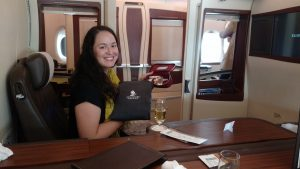 The first class suite on Singapore Airlines. Greeted with champaign and gifts upon boarding.